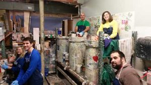 Group of volunteers recycling paint
