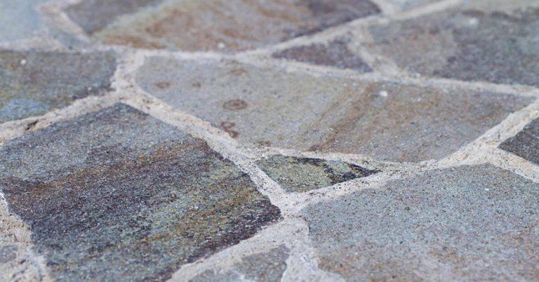 A close-up shot of a flagstone patio