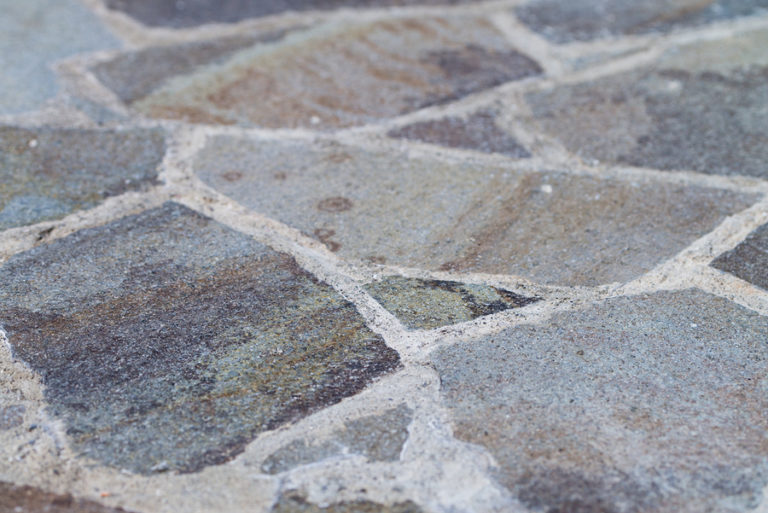 A close-up shot of a flagstone patio