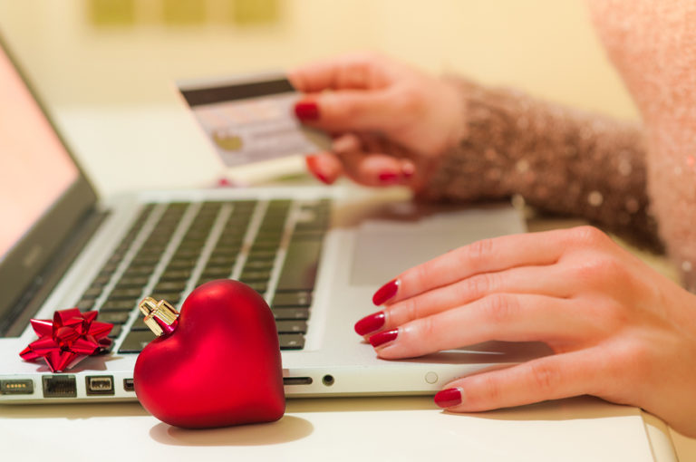 A close-up shot of a woman doing her online shopping on a laptop