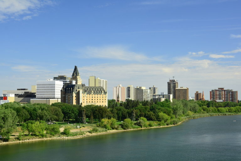 The Saskatoon skyline with the South Saskatchewan River in the foreground.