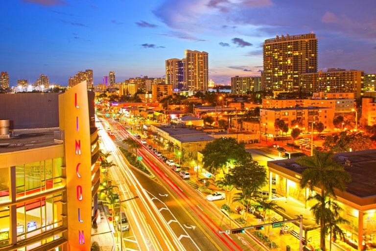 The sun rises over the city of Miami.