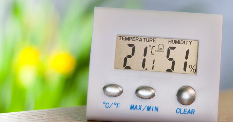 A hygrometer shows a humidity reading of 50 percent.