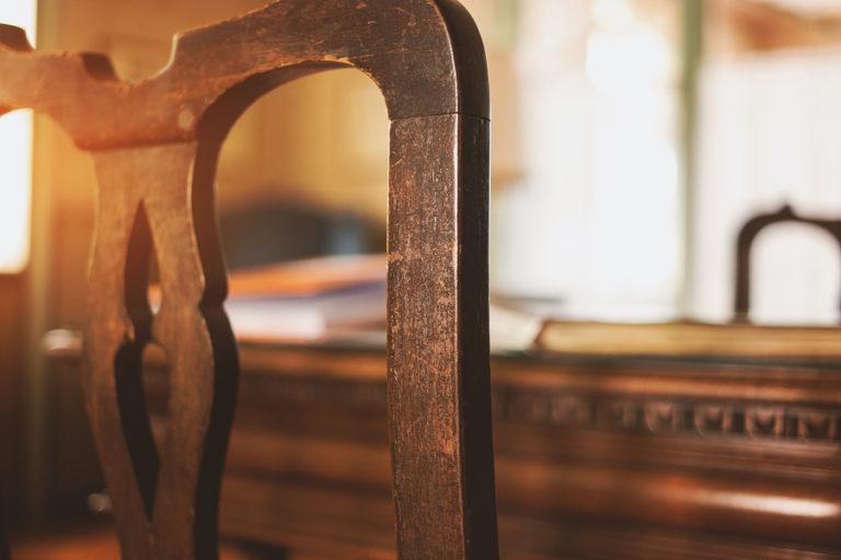 A close-up shot of an antique chair.
