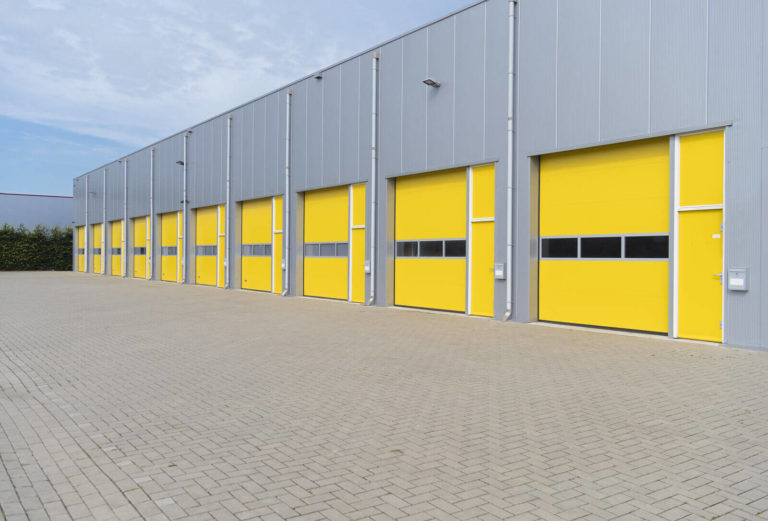 Exterior shot of a large commercial warehouse.
