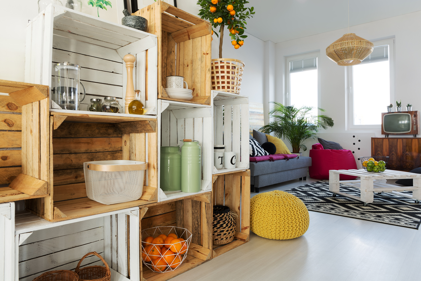 An assortment of wooden crates are stacked to create a DIY shelving unit.