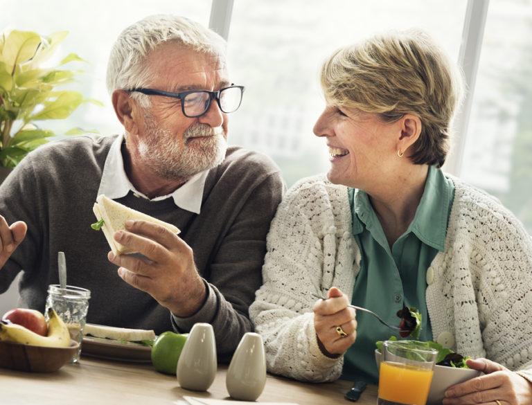 A senior couple enjoys breakfast together.