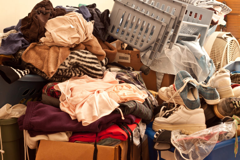 A room in a home is full of old clothes