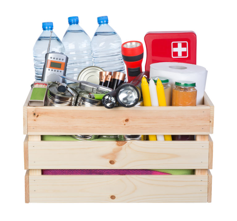 A wood crate full of emergency supplies