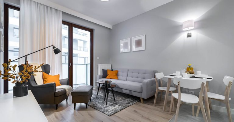 A living space has gray walls