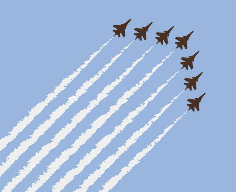Five planes soar overhead in an airshow.