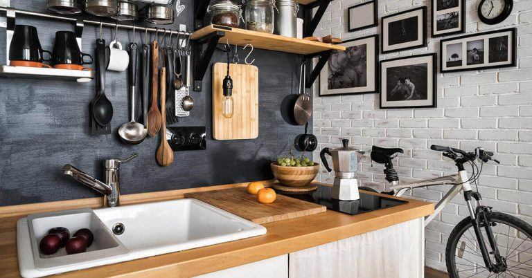 A kitchen gets organized with the help of hooks and shelves.