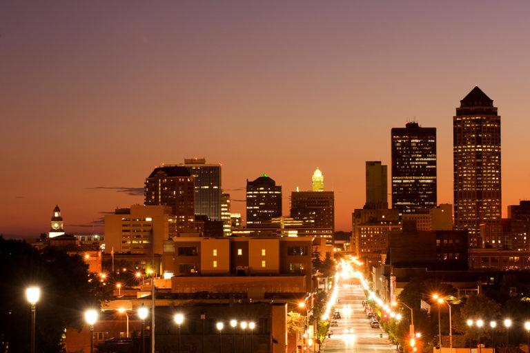 The Des Moines skyline twinkles at dusk.