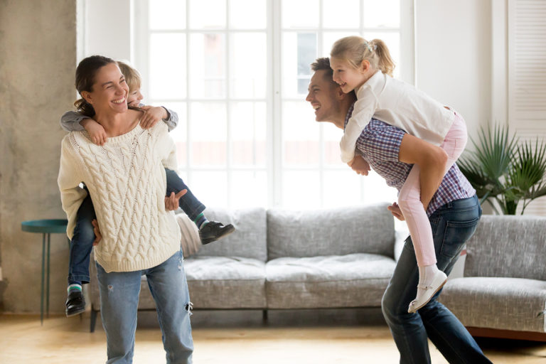 A mom spending time with her family in a clean house.