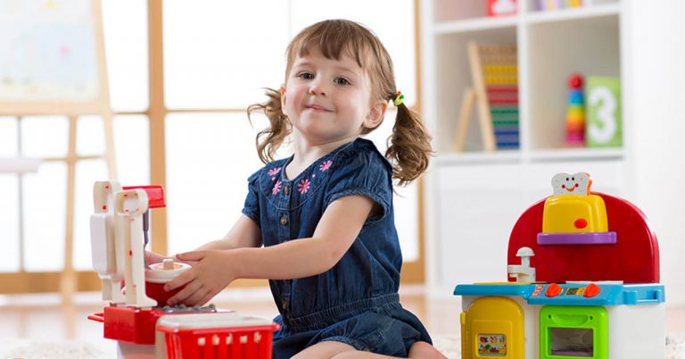 A young girl plays with toys.