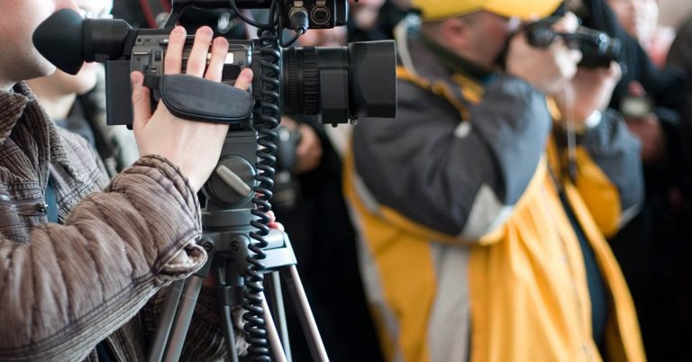 A close up shot of a people using their cameras.