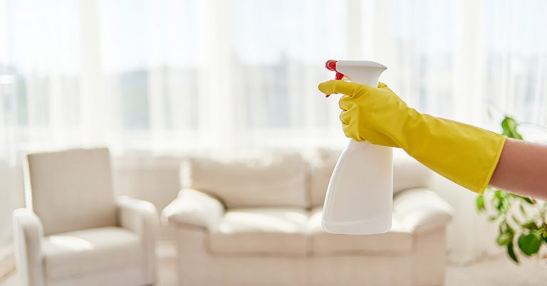 A woman is cleaning her living room