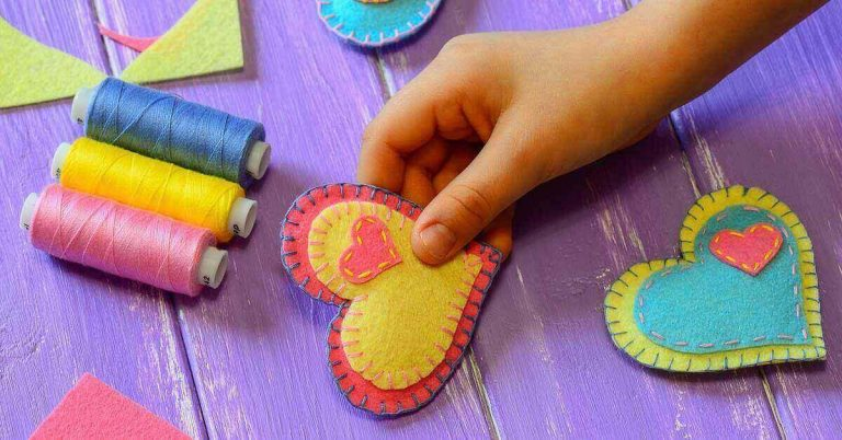 A child creates handmade Valentine's Day gifts at home.