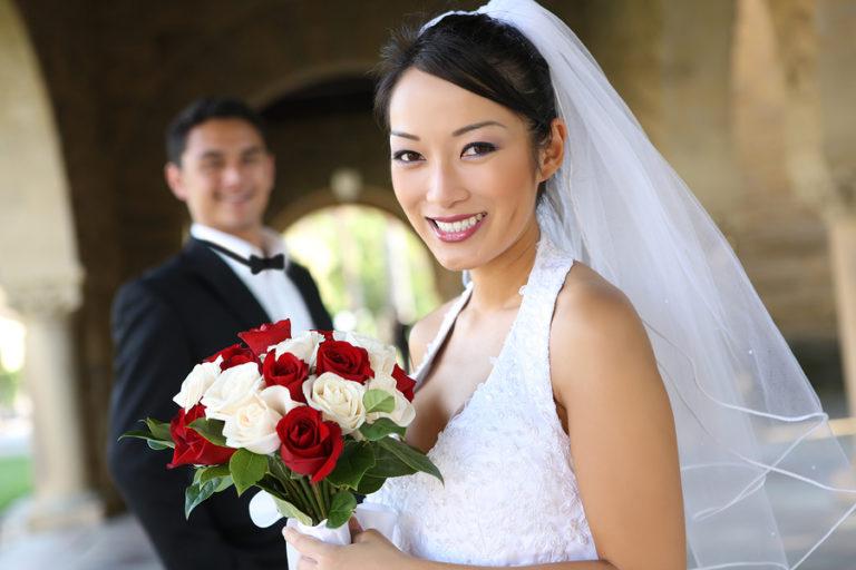 A bride smiles