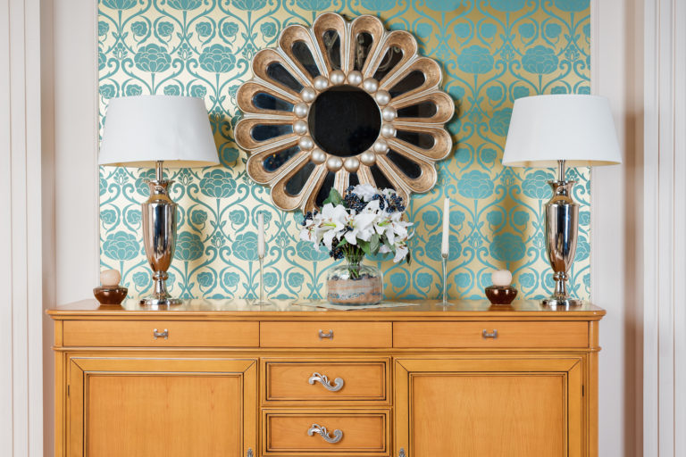 A console table is adorned with a geometric print