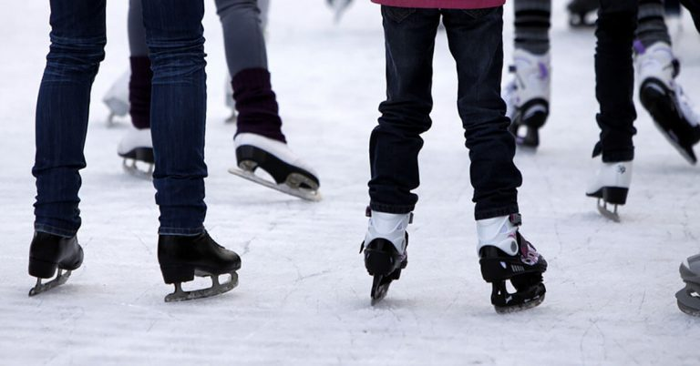 A close up shot of ice skaters.