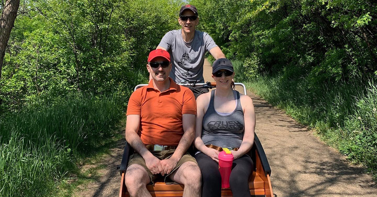 CNIB Kara Dibben and finder on trishaw bike