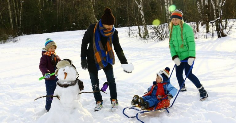 Family playing in the snow.