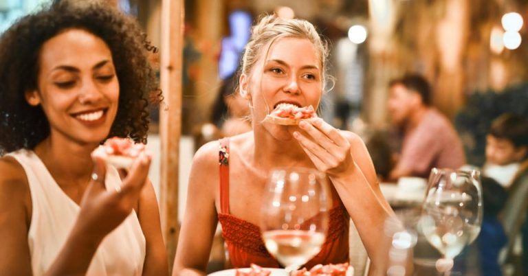 Women eating bruschetta pizza