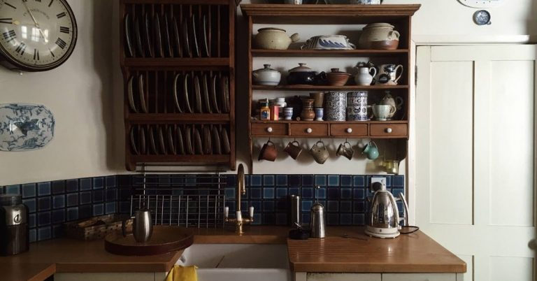 a small kitchen using wall space for organization