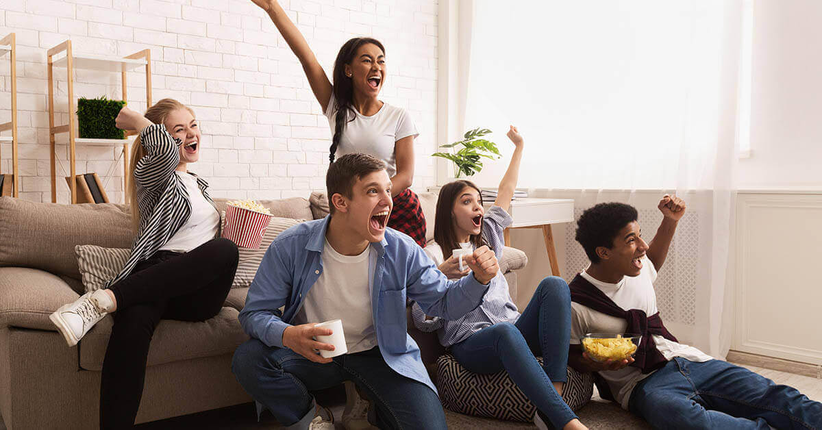 a group of friends watching football
