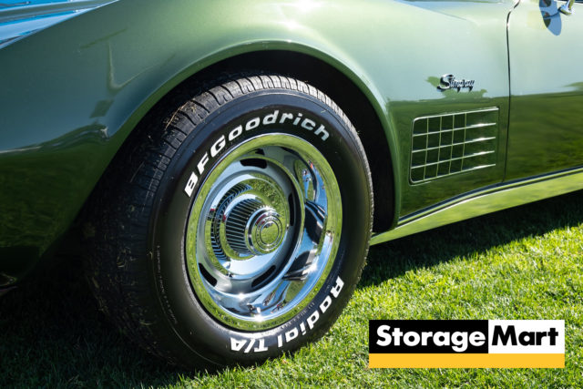 A hunter green Corvette with BF Goodrich Tires